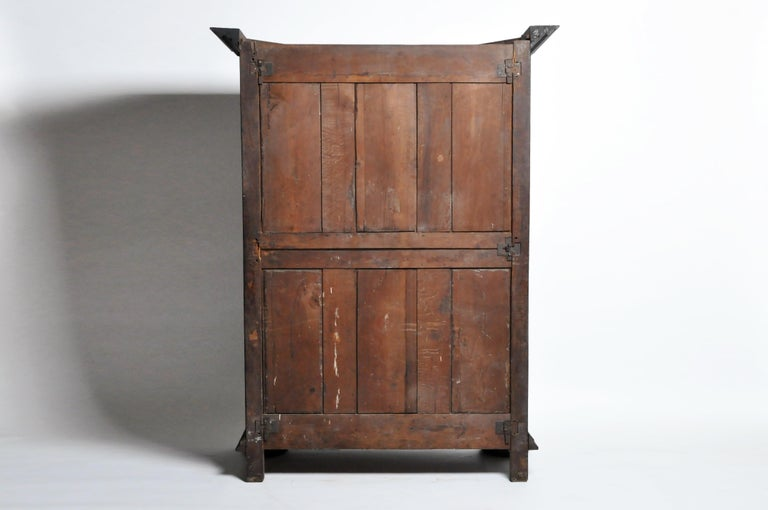 This handsome Louis XIII style armoire is from Lyons, France and was made from walnut wood, circa 18th century. The armoire's geometric style actually dates to a much earlier period but we think the piece is 18th century or early 19th. The piece