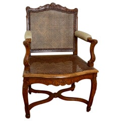 Louis XV Provincial Carved Walnut Armchair with Caned Seat and Back
