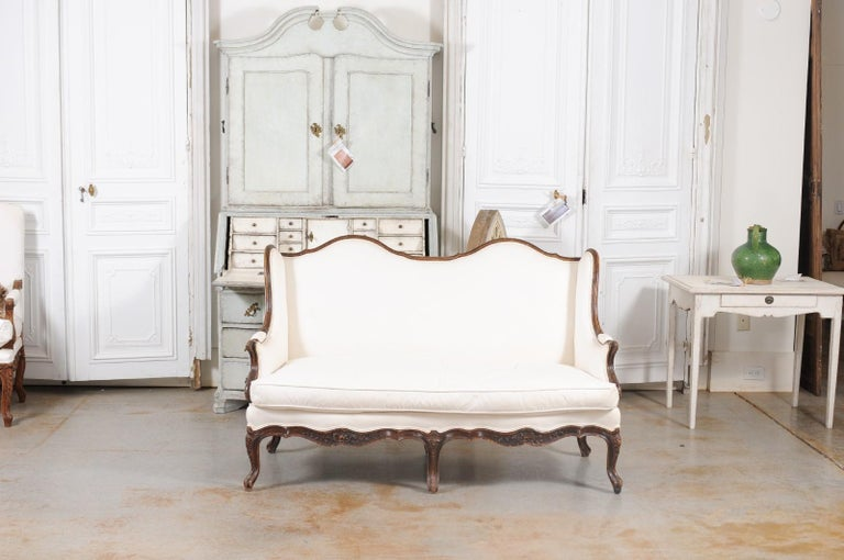 Louis XV Style 19th Century French Walnut Wingback Canapé with Cabriole Legs In Good Condition For Sale In Atlanta, GA