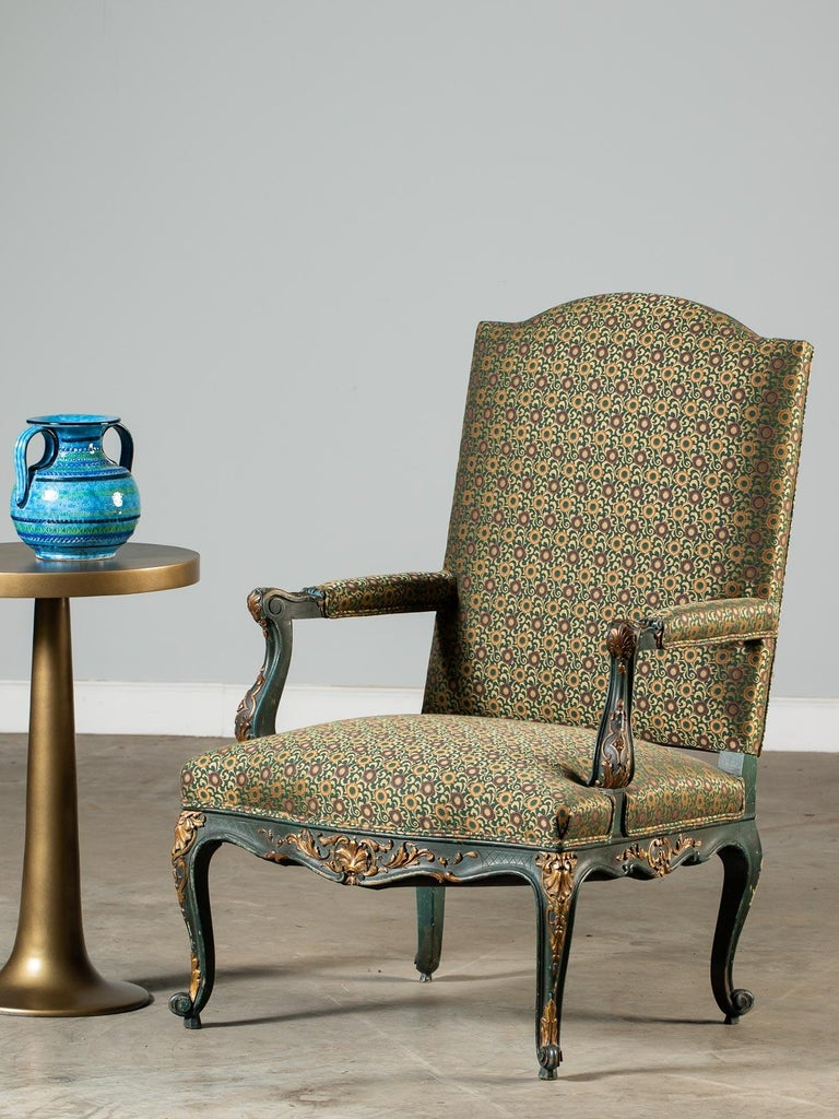 A beautiful antique French Louis XV style painted and gilded fauteuil (open armchair) circa 1875. Please notice the classic form created during the Regence period (1715-1723) where the soft curves flow across all areas of the chair. Please note how