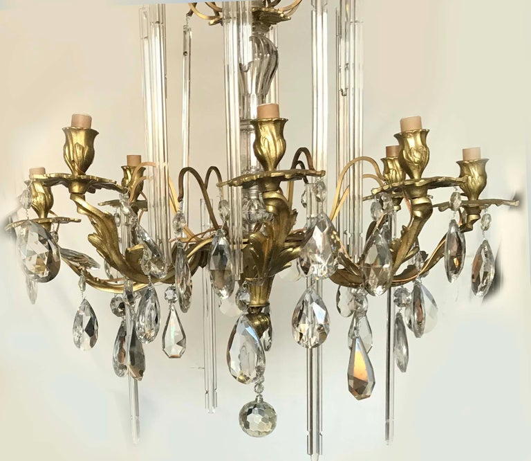 Superb bronze and crystal chandelier, 8 lights , 60 watts max bulb US rewired and in working condition Totally restored and refinished From A Nice côte D'azur estate.