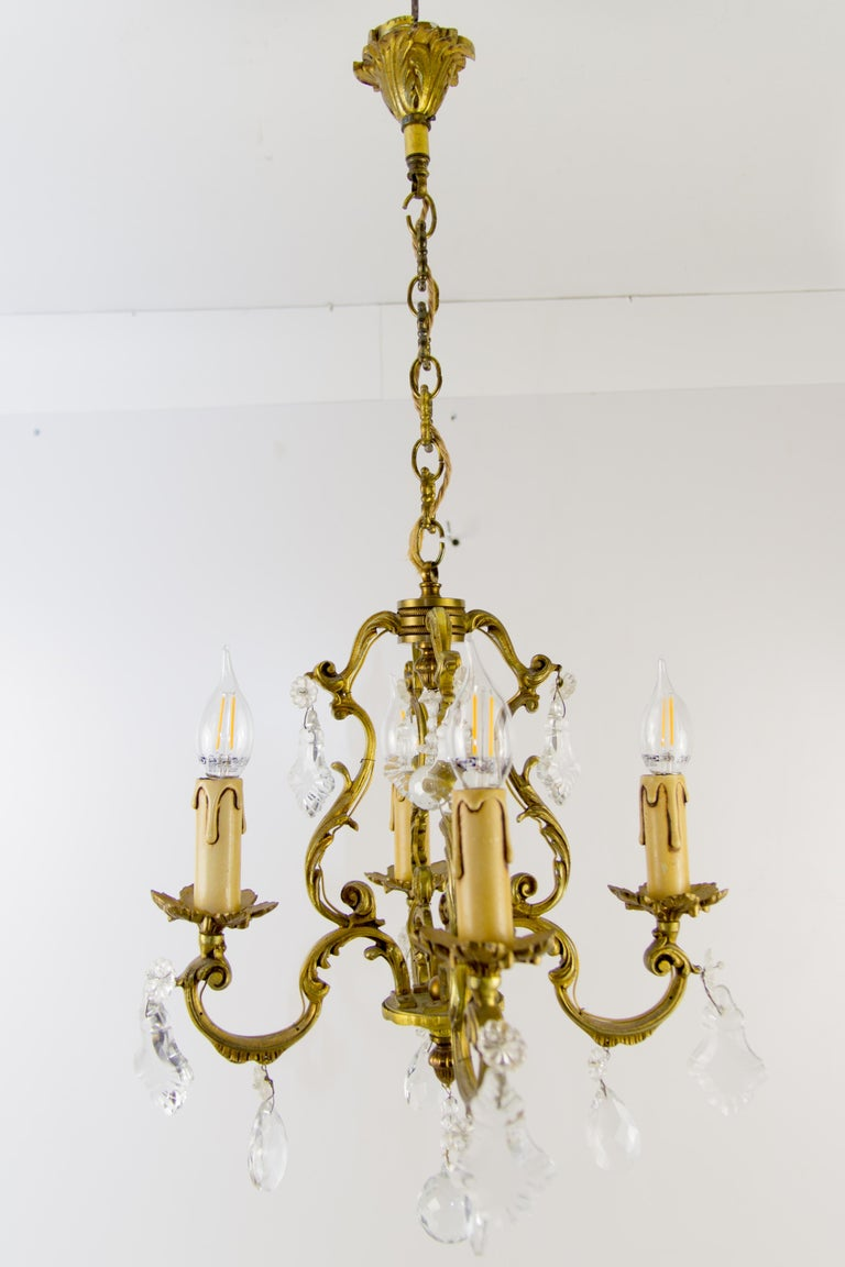 Very nice Louis XV style bronze and crystal four, light chandelier.