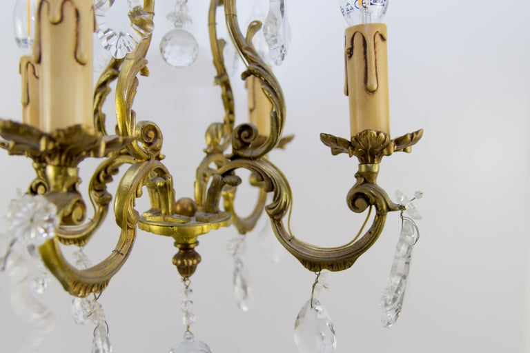 French Louis XV Style Bronze and Crystal Four-Light Chandelier For Sale