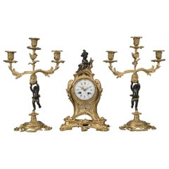 Louis XV Style Bronze Figural Clock Garniture by Maison Baguès French circa 1870