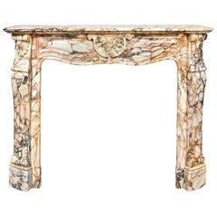 Louis XV-Style fireplace in Calacatta Rosato Marble