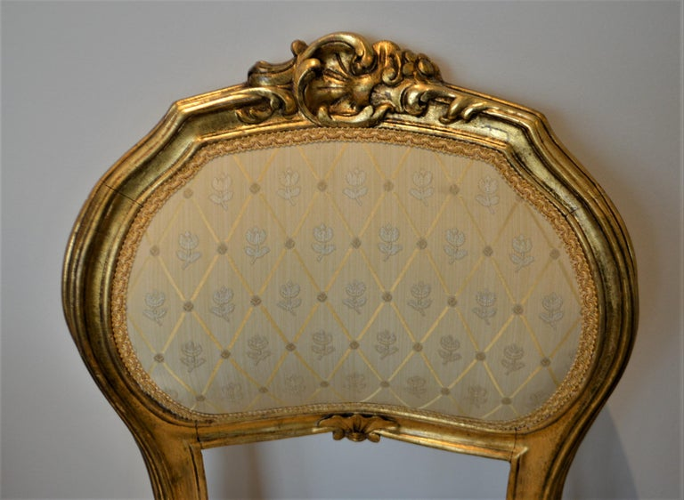 Pretty side accent chair, gilded, attractive hand carved details.