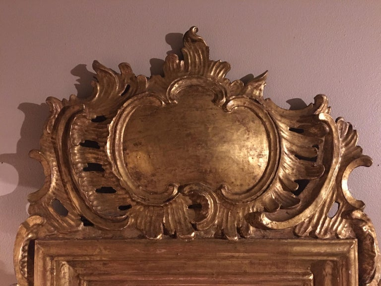 French Louis XV Style Giltwood Mirror with a Foliate Scroll Crest, 20th Century For Sale