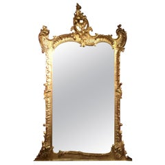 Louis XV-Style large giltwood mirror with impressive carving