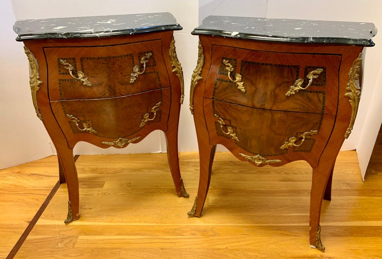 Pair of matching French Louis XV marble top, wood and bronze chests, nightstands, side tables. Now, more than ever, home is where the heart is.