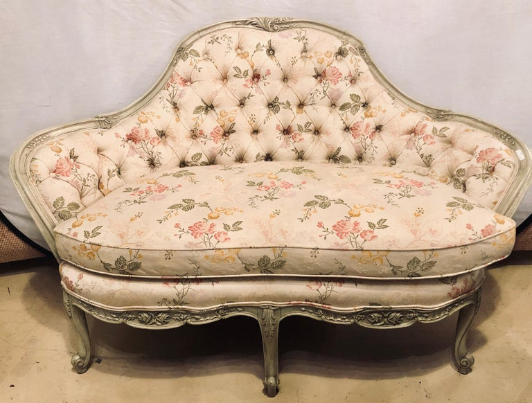 A French Louis XV style paint decorated settee tufted back with carved rosettes. A nicely carved settee or loveseat in the Swedish fashion.