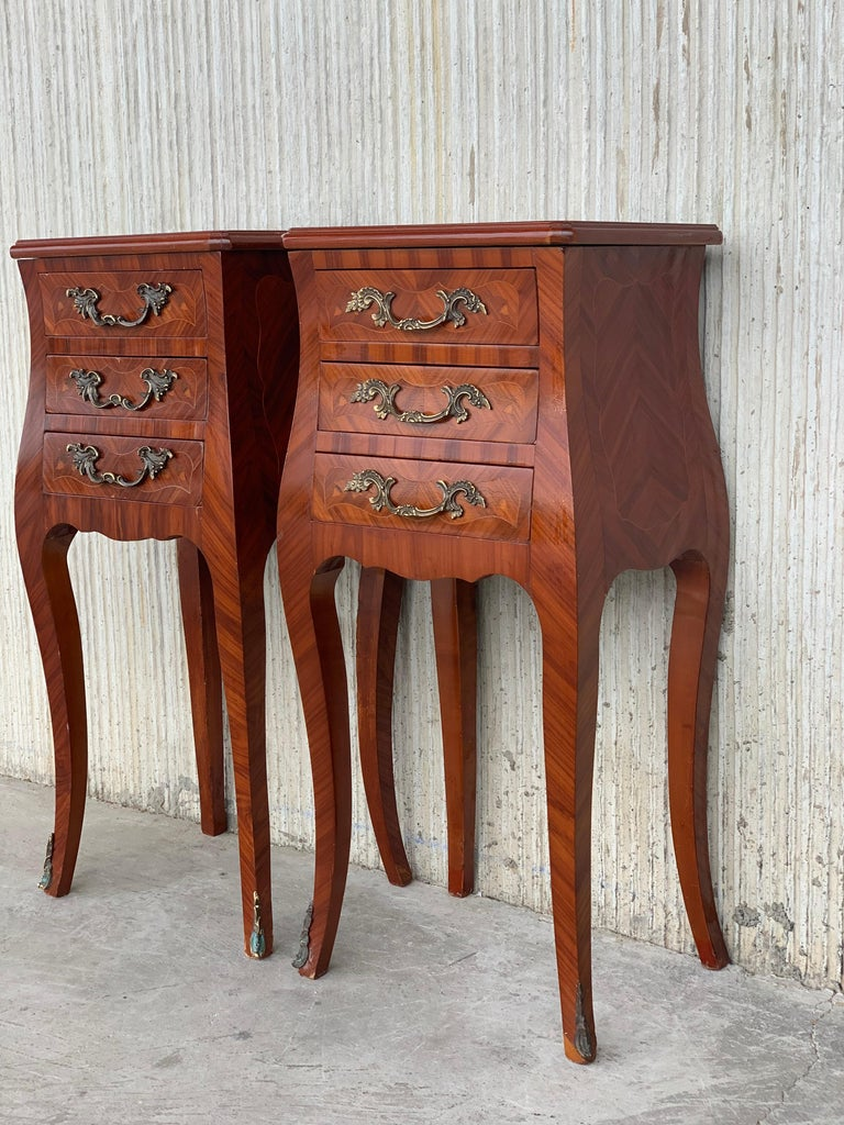 Louis XV style pair of marquetry nightstands with three drawers and cabriole legs.