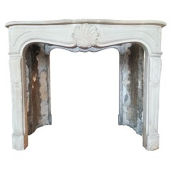 Louis XV Style, Parisian Fireplace Mantel Made in Clamart Stone, 20th Century