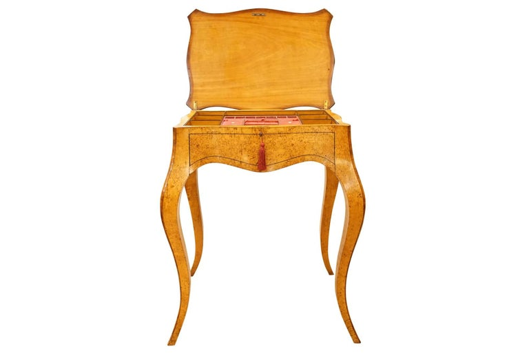 Louis XV style sewing box in burr birch with kingwood banding,    circa 1860.  Please note: The actual color of the wood is darker than the photograph shows.