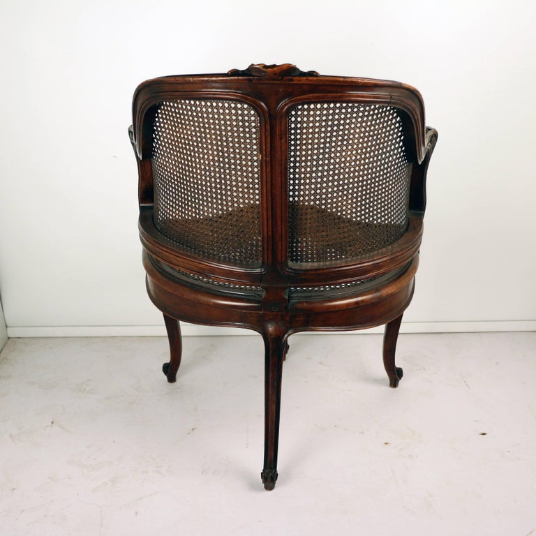 19th Century Louis XV Style Walnut and Caned French Provincial Bergere For Sale