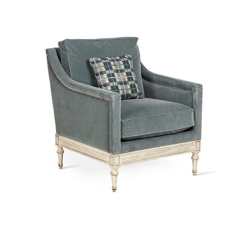 The Louis XVI armchair is characterized by straight armrests and a fully upholstered seat, with all the carvings completely hand-made. The structure is made in beechwood fully covered in light-blue fabric. The cushion is extra comfortable and in