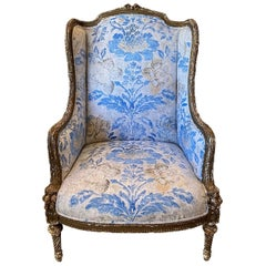 Louis XVI Berger a Oreilles, Armchair, Carved and Weathered Giltwood