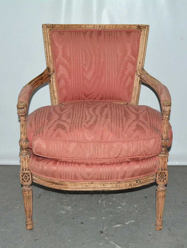 French Louis XVI stripped armchair giving it an informal casual charm with rose dust moire upholstered back & overstuffed feather seat cushion over fluted turned legs, wonderful hand carved details and proportions. Measures: Arm height 25.30