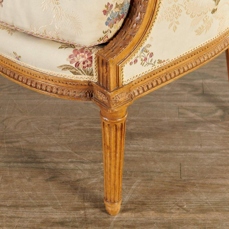 A fine Louis XVI period bergère in beech by French menuisier Sulpice Brizard, born 1735, master 1760, stamped under seat rail. Carved with acanthus leaves, beading, paterae, and fluting on the legs, the chair is an excellent example of the highest