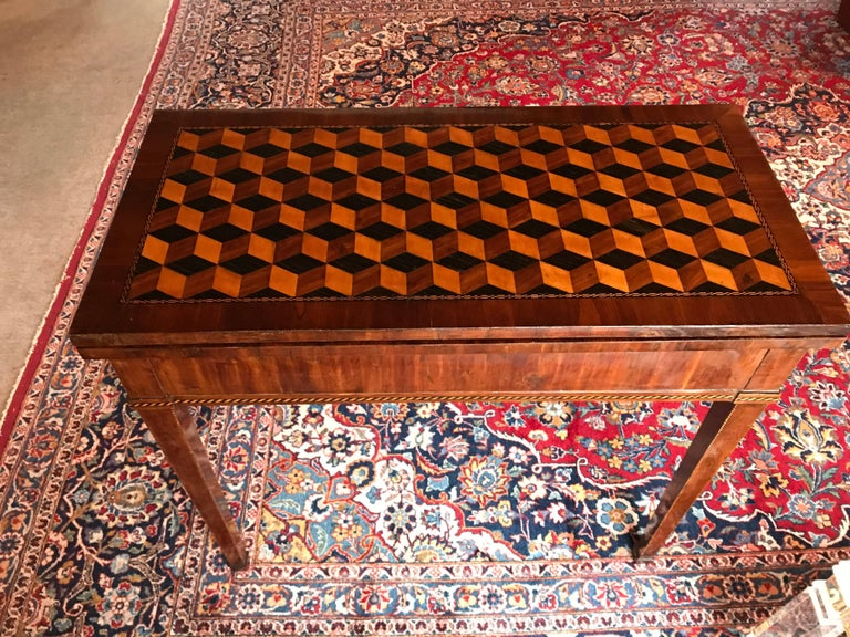 Unique 18th century Louis XVI card table, Strassburg region, king wood veneer and stunning satin wood, plum and king wood block marquetry on the top. The table is in very good condition with a nice original patina. It will be directly shipped from