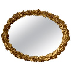 Louis XVI Carved Giltwood Oval Mirror with Oak Leaves and Acorns