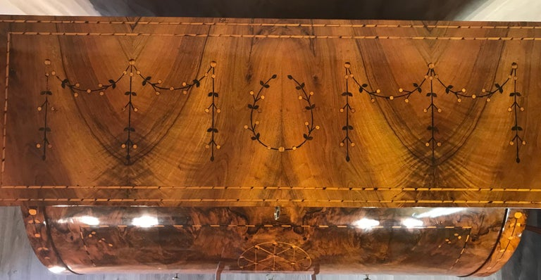 Louis XVI cylinder desk, South German 1780.  Walnut veneer with intarsia in yew and mahogany. The cylinder desk has a beautiful decor with geometric and garland motifs. The desk has been beautifully refinished.  It ships from Germany and includes