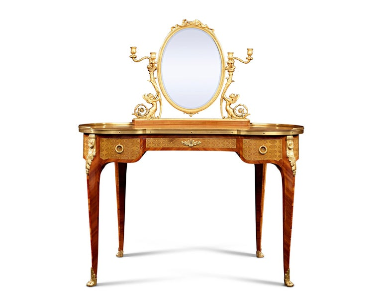 Eloquent marquetry and faithful interpretation of the Louis XVI taste characterize this beautiful 19th century dressing table by Paul Sormani. A graceful oval-shaped vanity mirror tops this impeccable design, ornamented with an ormolu framework of