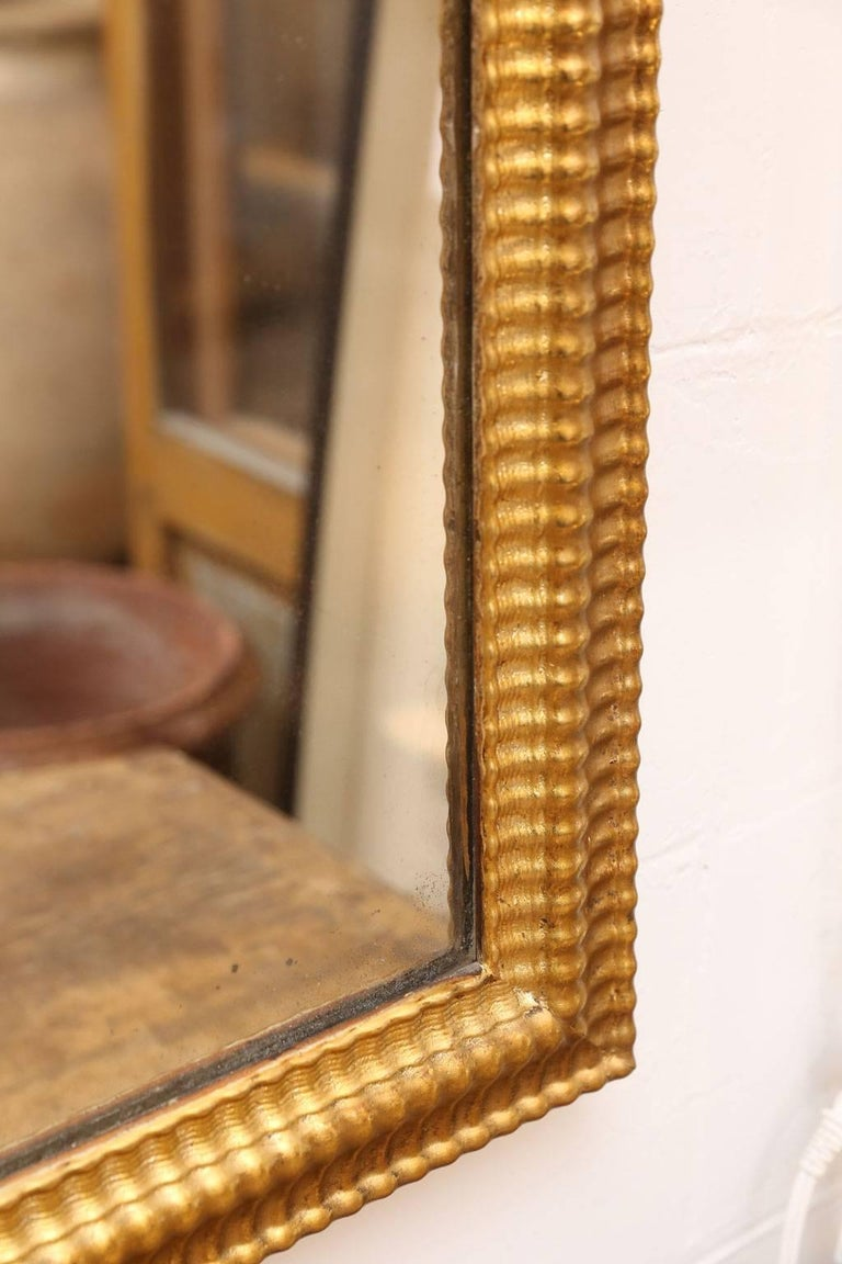 Hand-Carved Louis XVI Gilded Mirror For Sale
