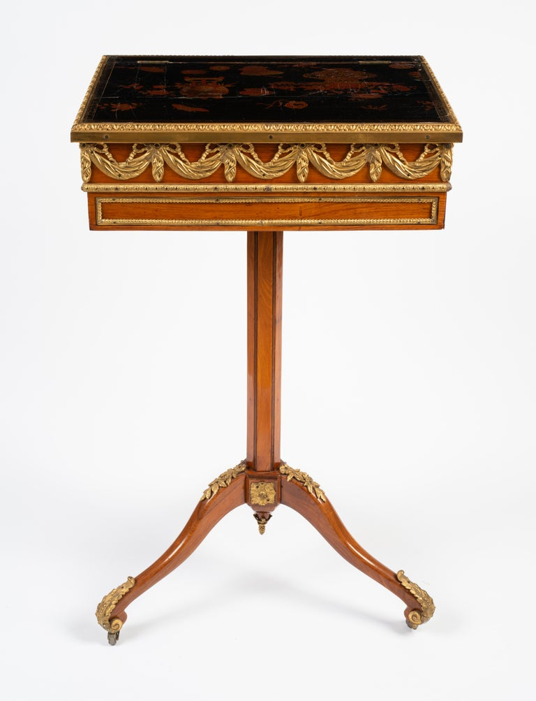 With later embellishments, the rectangular ratcheted and adjustable raisable top with book stop and lacquered top depicting vessels and plants, the ratchet with fold-out book stop, above the frieze with two opposing drawers, one fitted drawer with