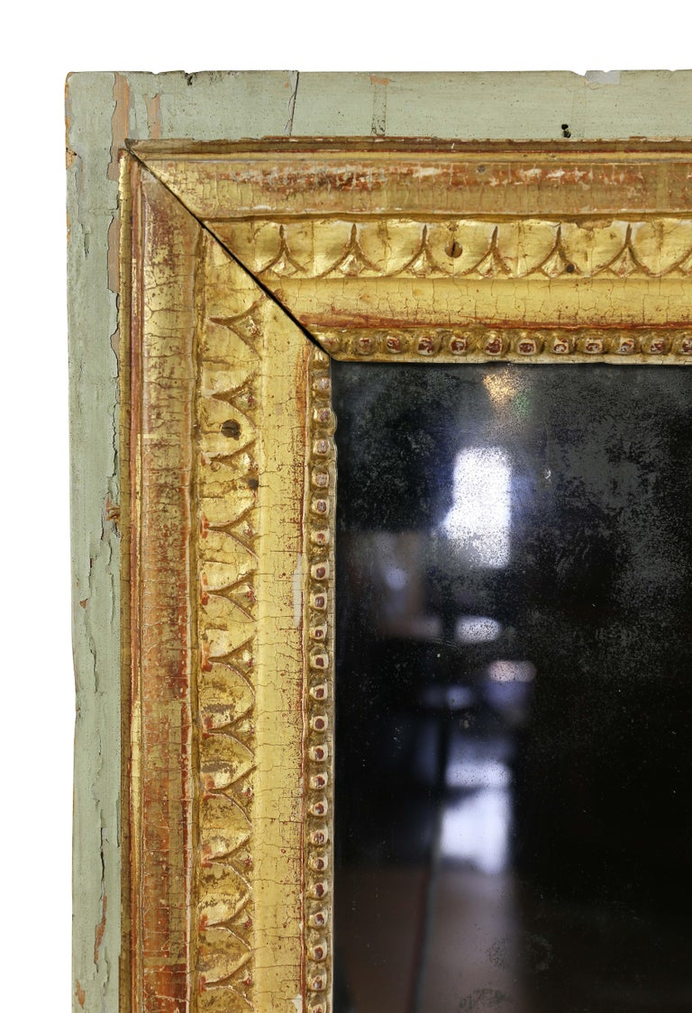 Rectangular with light green outer border and gilt inner band with leaf tip and beaded decoration. Two part old mirror plate with oxidation. Provenance; William Hodgins , Boston.