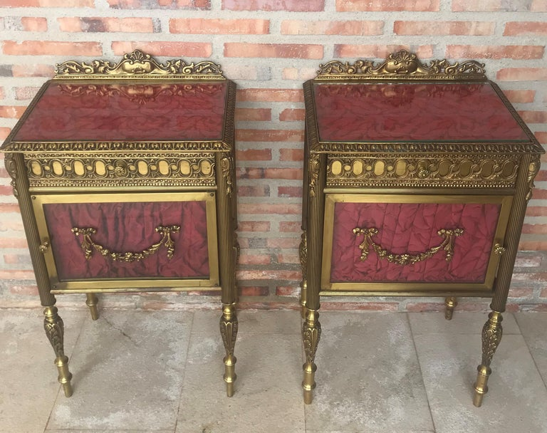 19th century pair of bronze nightstands with glass door and drawers.  This early antique Louis XVI style bronze or glass vitrine cabinet or nightstand is simply stunning and constructed of the finest quality. The bronze mounts of fine form with a
