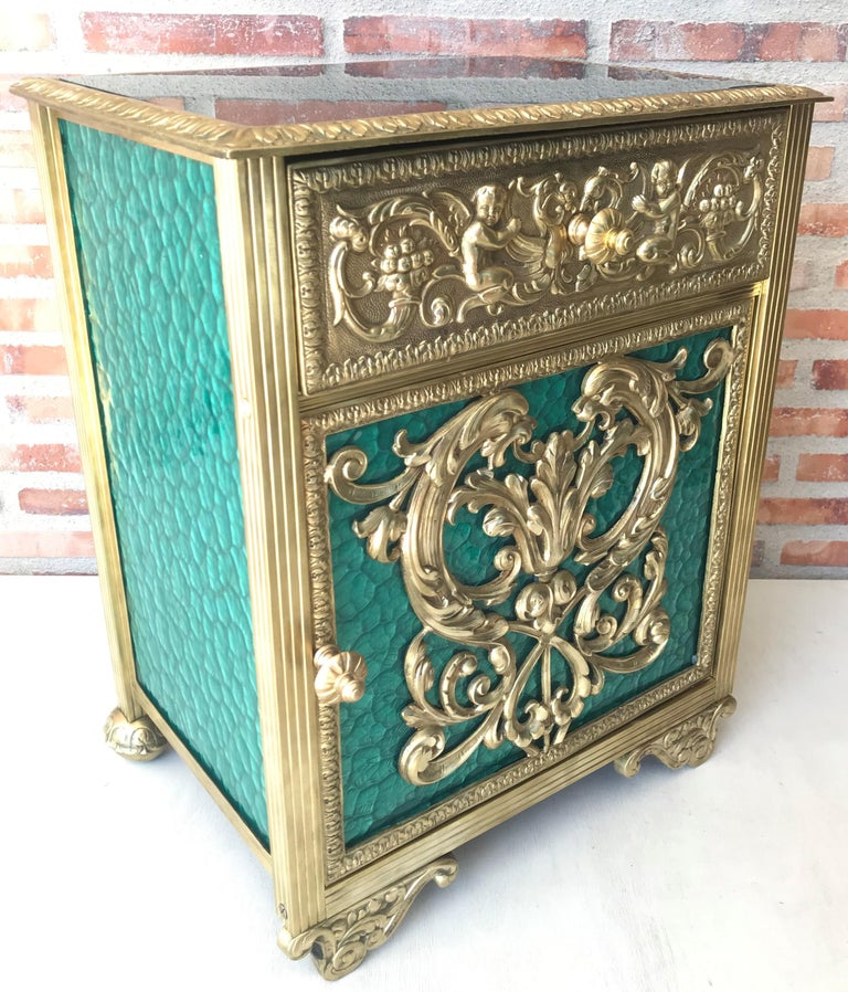 20th century pair of bronze nightstands with green glass doors and drawers .  This early antique Louis XVI style bronze or glass vitrine cabinet or nightstand is simply stunning and constructed of the finest quality. The bronze mounts of fine form