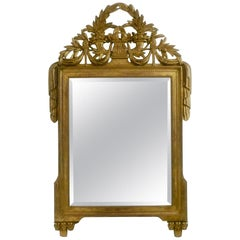 Louis XVI Period Carved and Gilded Wood Framed Beveled Mirror