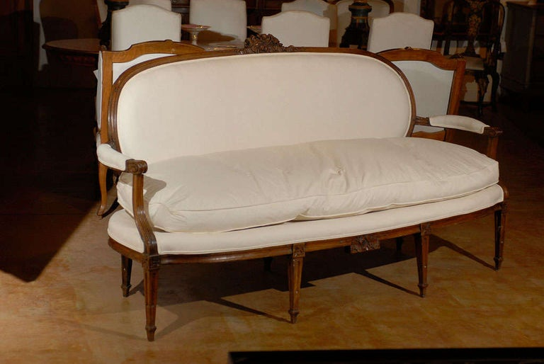 A French Louis XVI period Provençal sofa from the late 18th century, signed by Pillot from Nîmes with new cotton upholstery. Created by Pierre Nicolas Pillot, cabinet-maker who worked in the South of France at the end of the 18th, early 19th