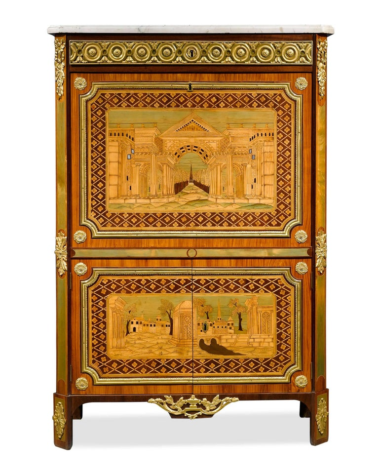 This elegant Louis XVI secrétaire à abattant was crafted by the master ébéniste André Gilbert, a craftsman renowned for his extraordinary talent for marquetry. This cabinet is a superb example of his architectural inlaid designs, featuring colorful