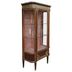 Louis XVI Style Bookcase in Curved Glass Marble Bronze and Marble Top circa 1880
