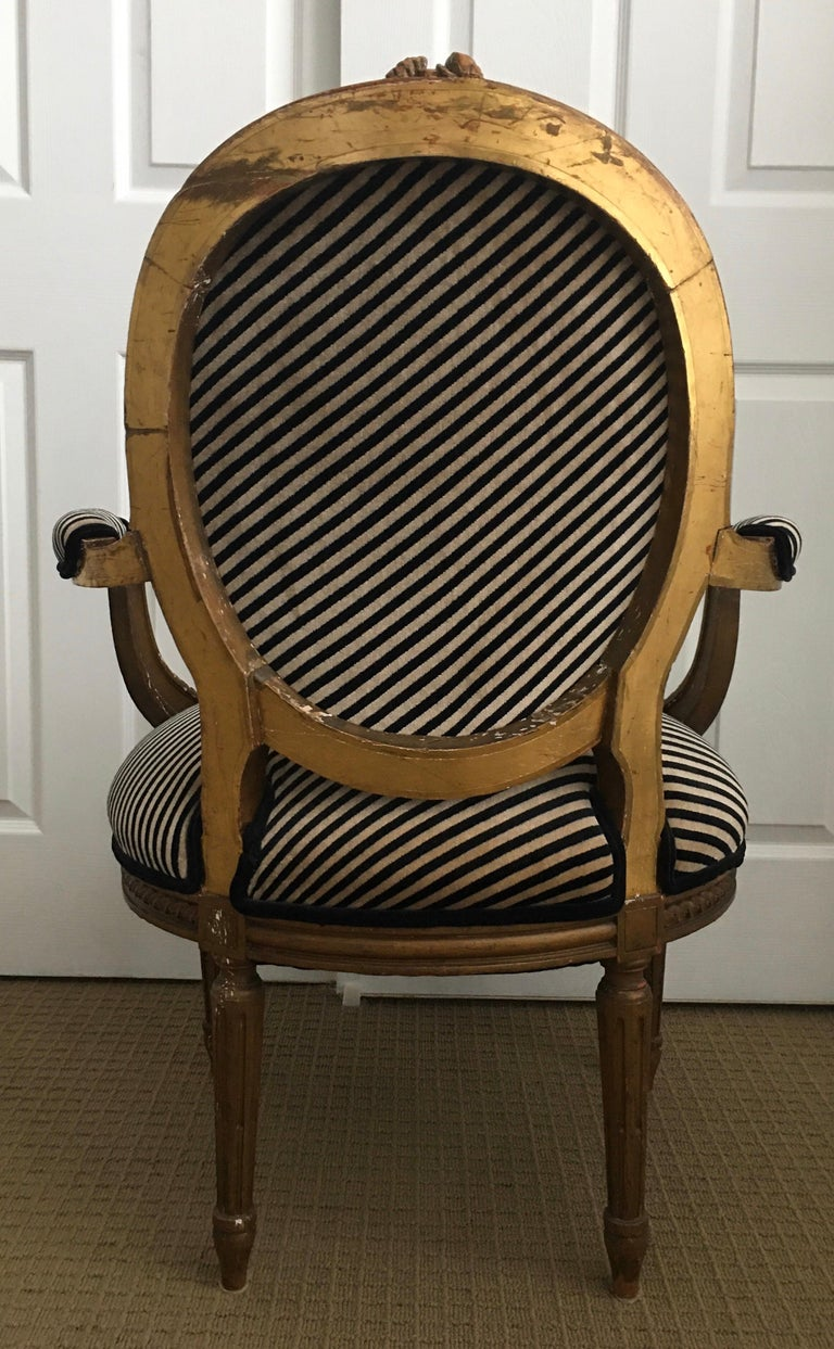 20th Century Louis XVI Style Carved Giltwood Armchair with Modern Stripe Upholstery For Sale