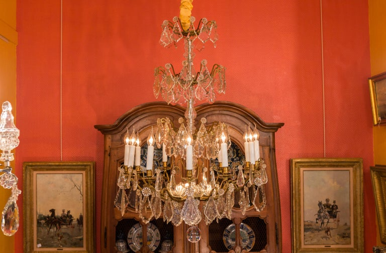 Louis XVI style, French mid-20th century, bronze and crystal chandelier, circa 1950.  A large, elegant and decorative gilt-bronze and cut-crystal chandelier in the classic French Louis XVI style.  Our chandelier is composed of twelve perimeter