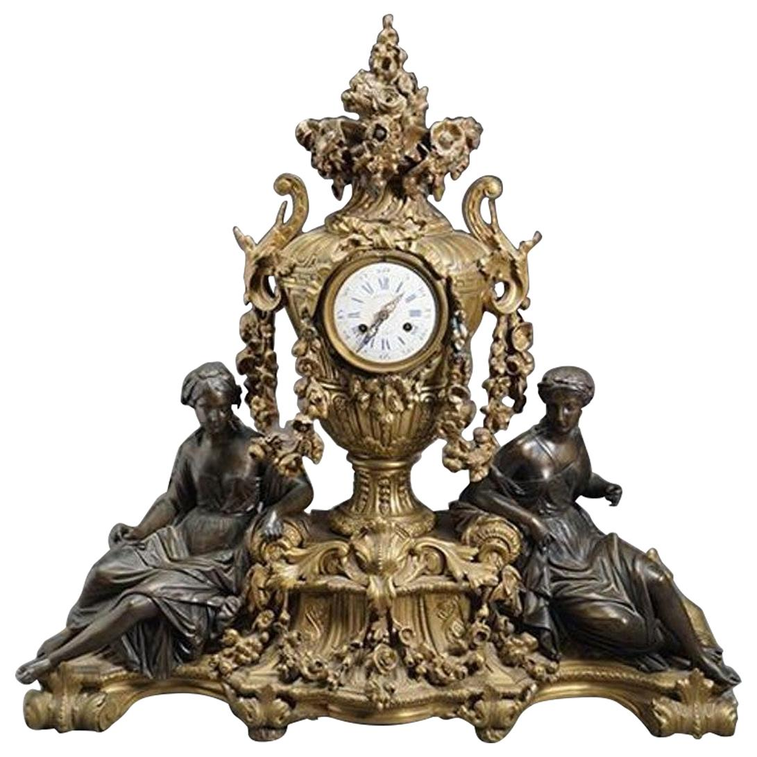 Louis XVI Style Gilt and Patinated Figural Bronze Clock
