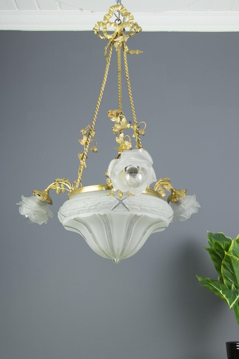Early 20th Century Louis XVI Style Gilt Bronze and Frosted Glass Chandelier with Bronze Flowers For Sale