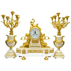 Louis XVI Style Gilt Bronze and White Marble Candelabra and Clock Garniture
