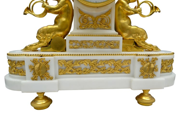 Hand-Carved Louis XVI Style Gilt Bronze and White Marble Clock with Bacchante and Satyrs For Sale