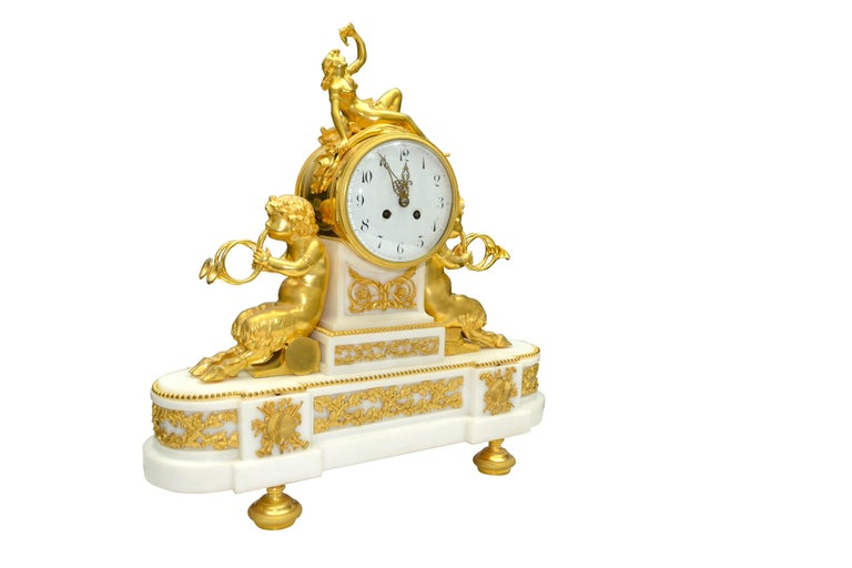 19th Century Louis XVI Style Gilt Bronze and White Marble Clock with Bacchante and Satyrs For Sale