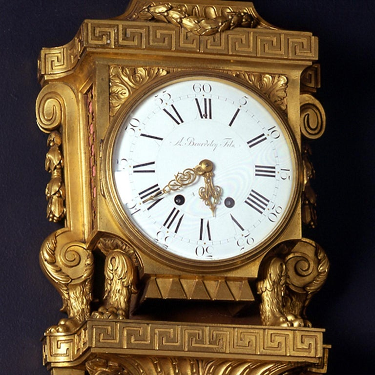 A fine Louis XVI style gilt-bronze Cartel clock, by Beurdeley.   Signed 'A Beurdeley Fils à Paris'.  Surmounted by a ribbon tied globe the gilt-bronze case of this fine cartel clock presents a rich decorative vocabulary inspired by classical