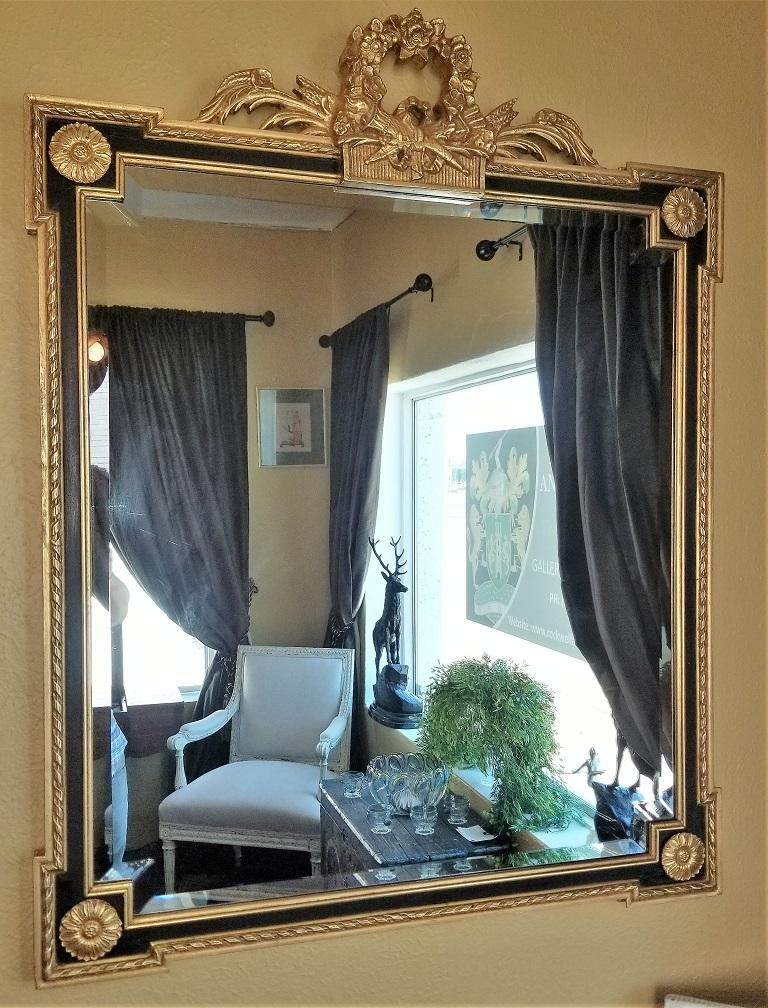 20th Century Louis XVI Style Giltwood and Ebony Beveled Glass Mirror For Sale