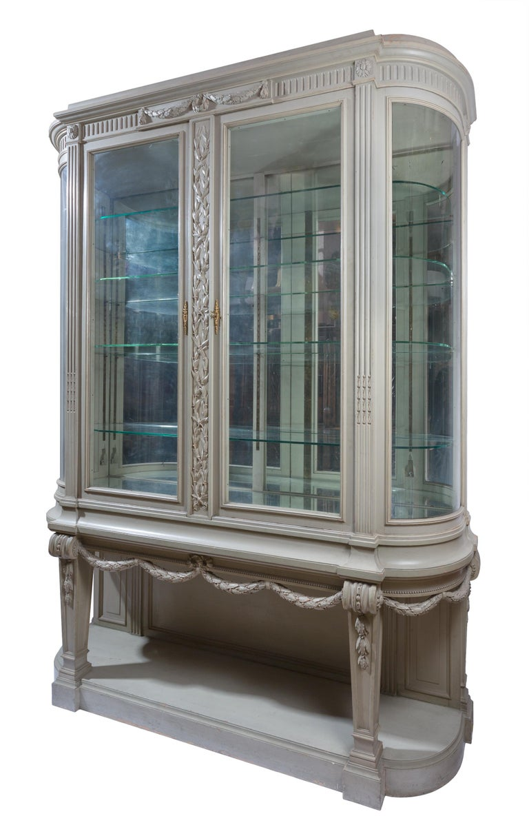 This rare 19th century Gris Trianon (Trianon Gray) Louis XVI style Vitrine / display cabinet / china cabinet by François Linke is constructed of oak and has its original (and unusual) painted grey-green finish. The vitrine was part of a larger group
