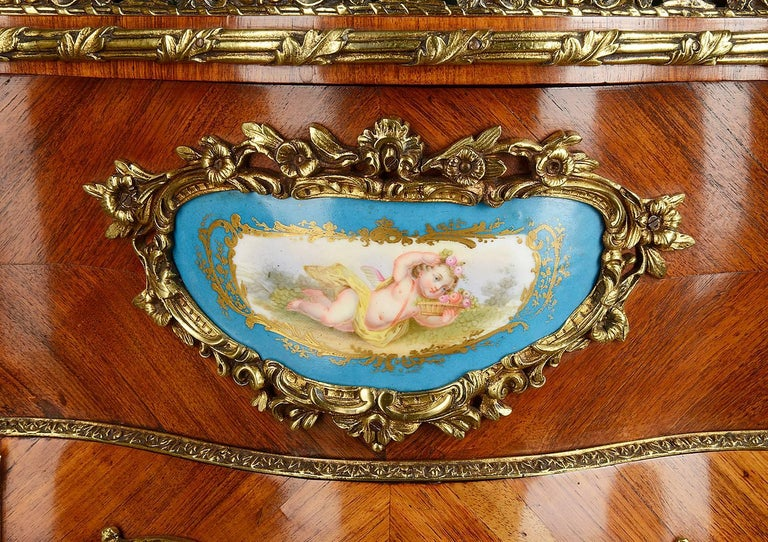A very good quality 19th century Louis XVI style kingwood jardiniere on stand, having gilded ormolu mounts and inset Sèvres style porcelain plaques.