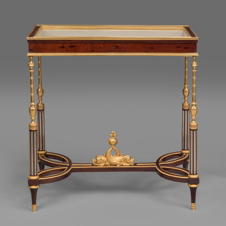 A rare pair of Louis XVI style gilt-bronze mounted vitrine tables in the manner of Weisweiler, by Georges-François Alix.
