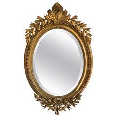 Louis XVI Style Oval Framed Giltwood Beveled Mirror Wreath Ribbon Shell Design