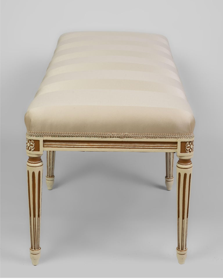 Carved Louis XVI Style Parcel Cream and Brown Painted Bench For Sale