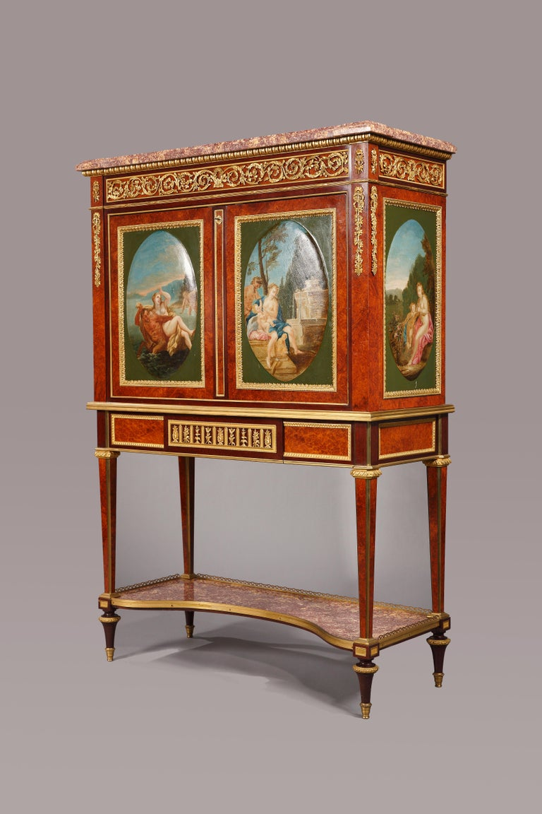 A very fine Louis XVI style upright secretary, executed in veneered wood, finely decorated with painted medallions representing mythological scenes. Fine chiseled and gilded bronze mounts.